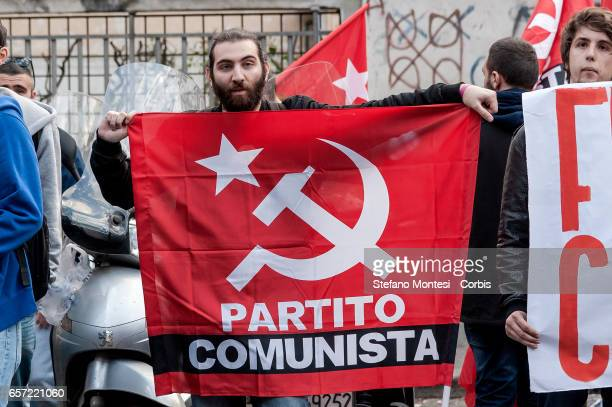 The militants of the Front of the Communist Youth protest shouting 'Tsipras sold are not welcome' the participation of Greek Prime Minister Alexis...