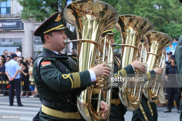The Military Band of the Chinese People's Armed Police Force perform during the opening parade of the 5th Nanchang International Military Tattoo on...