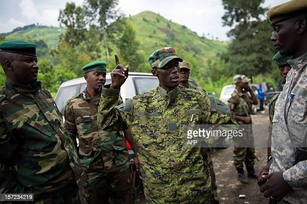 The military chief of the M23 rebels BrigadierGeneral Sultani Makenga addresses officers whilst visiting withdrawing troops near to the town of Sake...
