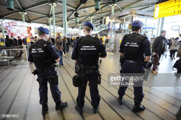 The military police carries extra patrols at Schiphol Airport in Amsterdam on March 22 2016 in response to the attacks in the departure hall of...