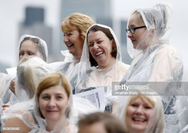 The Military Wives choir brave the rain during a launch event for their new recording of 'Pack Up Your Troubles' proceeds of which will benefit...