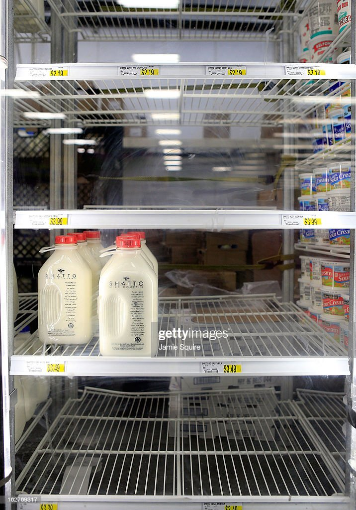 The milk shelves are mostly clear at a Price Chopper grocery store after the area is hit by a snowstorm on February 26, 2013 in Kansas City, Missouri. This is the second major snowstorm the midwest has seen this week dropping a half-foot or more of snow across Missouri and Kansas and cutting power to thousands...