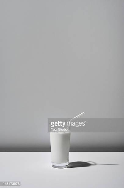 The milk which a glass contains on white backgroun