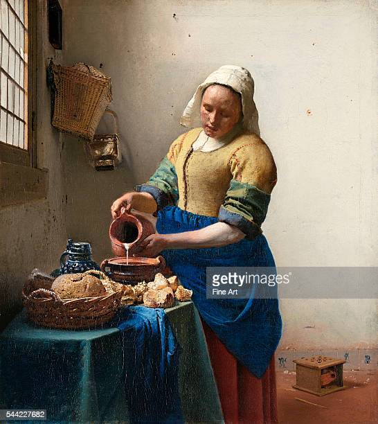 The Milkmaid or The Kitchen Maid circa 1658 Oil on canvas 41 x 455 cm Rijksmuseum Amsterdam Netherlands   Located in Rijksmuseum