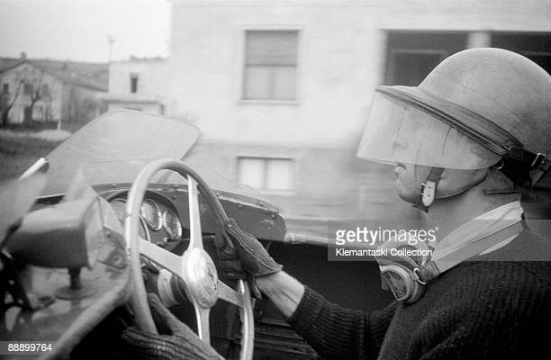 The Mille Miglia April 2829 1956 Peter Collins at speed in the Ferrari 860 Monza in the rain Note the special Nardi fourspoke wheel preferred by him