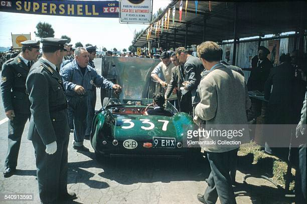 The Mille Miglia May 1112 1957 Gregor Grant has his Lotus XI serviced at the Rome control Grant was being sprayed with fuel from a leaking tank and...