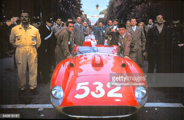 The Mille Miglia May 1112 1957 Waiting for the start the Ferrari mechanics push the car of von Trips toward the ramp