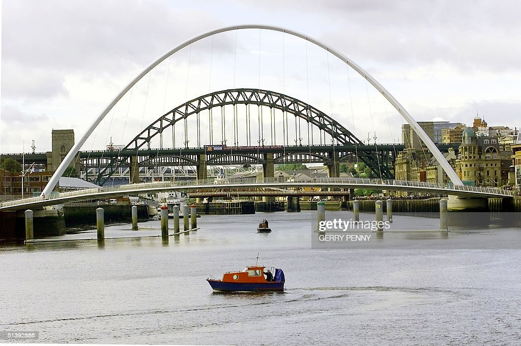 The Millennium Bridge the rotating bridge nears completion 05 September 2001 across the river Tyne in front of the famous Tyne Bridge in Newcastle...