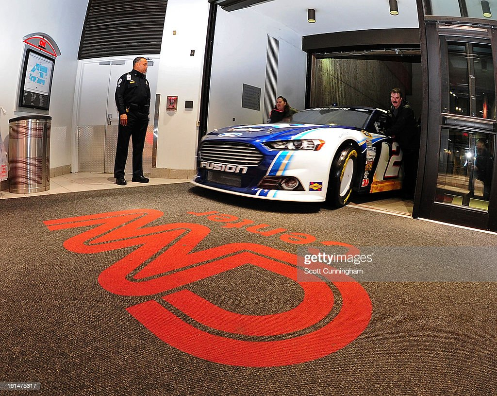 The #2 Miller Lite Ford driven by <a gi-track='captionPersonalityLinkClicked' href=/galleries/search?phrase=Brad+Keselowski&family=editorial&specificpeople=890258 ng-click='$event.stopPropagation()'>Brad Keselowski</a> (not pictured) enters the CNN Center during the Road to Daytona Fueled By Sunoco Tour on February 11, 2013 in Atlanta, Georgia.