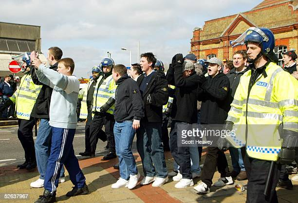 The Millwall fans are escorted out of Upton Park station prior to the Coca Cola Championship match between West Ham and Millwall at Upton Park on...