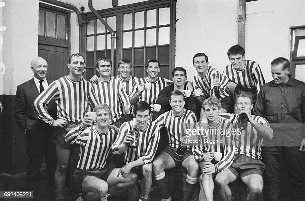 The Millwall FC team celebrate in their changing room after equalling the league record of unbeaten athome wins London 13th November 1966
