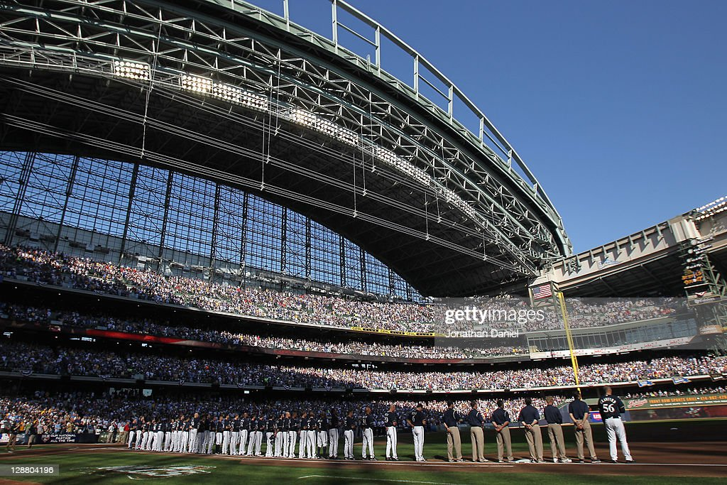 The Milwaukee Brewers line up on the foul line during the performance of the National Anthem against the St Louis Cardinals during Game one of the...