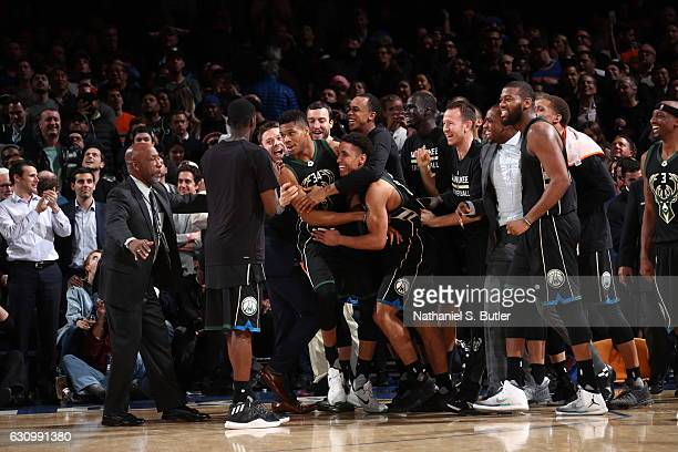 The Milwaukee Bucks celebrate with Giannis Antetokounmpo after he hits the game winning shot against the New York Knicks on January 4 2017 at Madison...