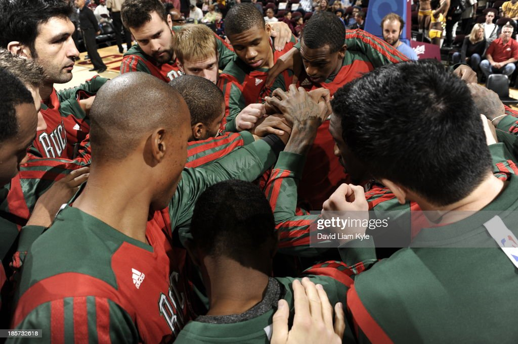 The Milwaukee Bucks huddle up before the game against the Cleveland Cavaliers at The Quicken Loans Arena on October 8, 2013 in Cleveland, Ohio.