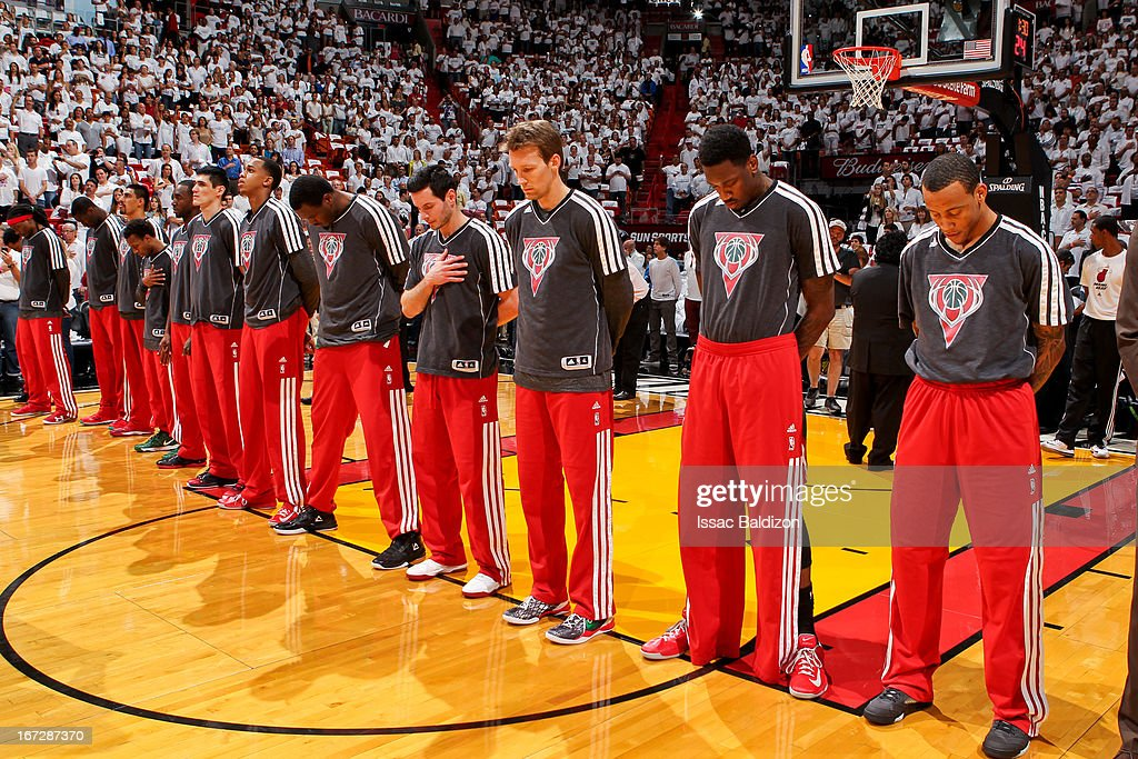 The Milwaukee Bucks listen to the National Anthem before playing against the Miami Heat in Game Two of the Eastern Conference Quarterfinals during the 2013 NBA Playoffs on April 23, 2013 at American Airlines Arena in Miami, Florida.
