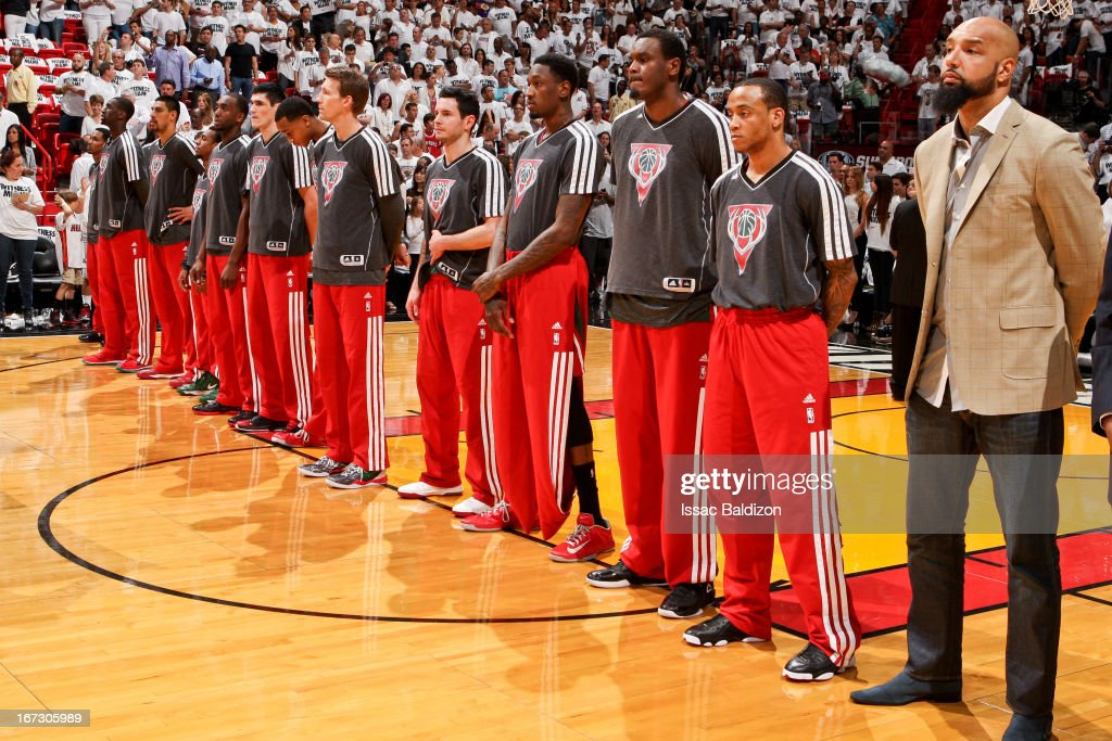 The Milwaukee Bucks listen to the National Anthem before playing against the Miami Heat in Game One of the Eastern Conference Quarterfinals during the 2013 NBA Playoffs on April 21, 2013 at American Airlines Arena in Miami, Florida.