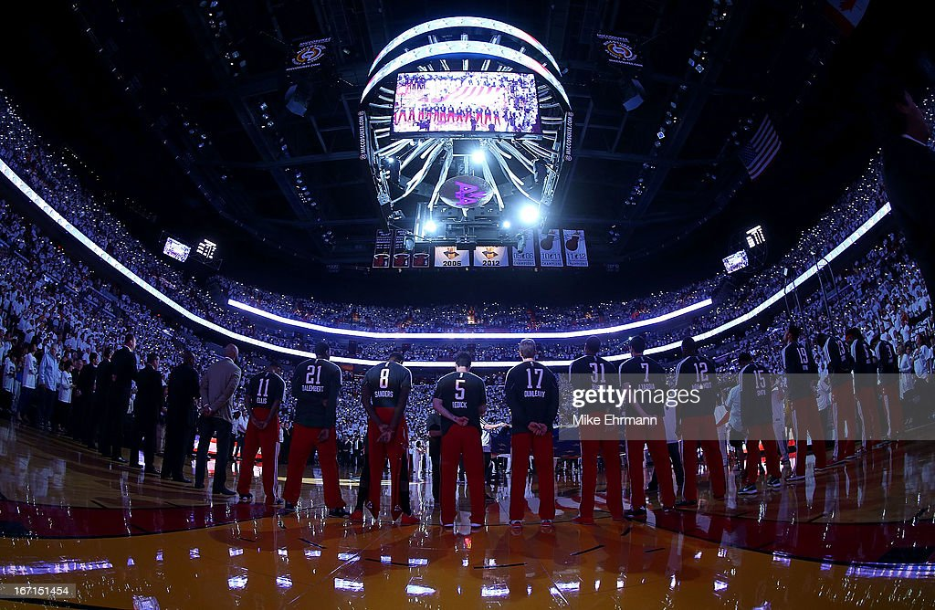 The Milwaukee Bucks stand for the National Anthem during Game 1 of the Eastern Conference Quarterfinals of the 2013 NBA Playoffs against the Miami Heat at American Airlines Arena on April 21, 2013 in Miami, Florida.