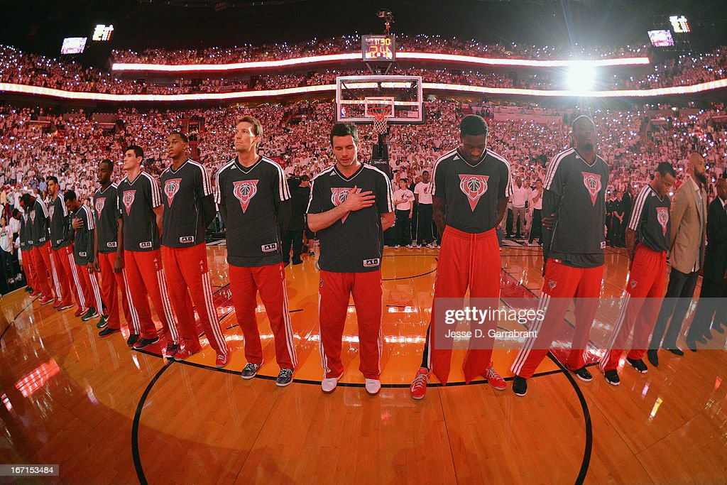 The Milwaukee Bucks stand for the National Anthem prior to their game against the Miami Heat in Game One of the Eastern Conference Quarterfinals during the 2013 NBA Playoffs on April 21, 2013 at the American Airlines Arena in Miami, Florida.