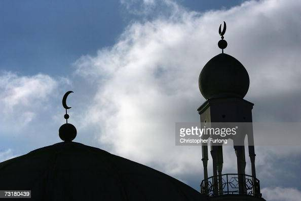 The minaret and dome of the Birmingham Central Mosque dominate the skyline as Muslims arrive for friday prayers on 2 February Birmingham England...