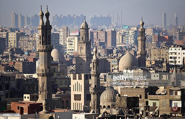 The minaret's of mosques are pictured in Cairo on November 8 2014 AFP PHOTO / MOHAMED ELSHAHED