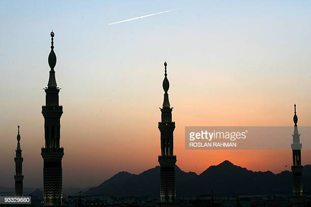 The minarets of the Prophet Mohammed Mosque are silhouette against the sunset in the holy city of Medina in Saudi Arabia 11 December 2007 Eid alAdha...