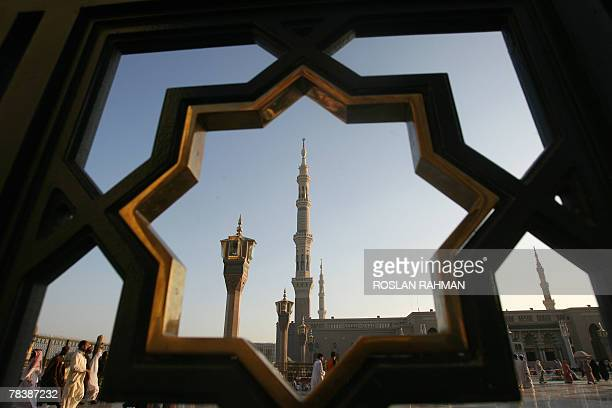 The minarets of the Prophet Mohammed Mosque is seen through the gate as Muslim pilgrims arrive for the evening prayer in the holy city of Medina in...