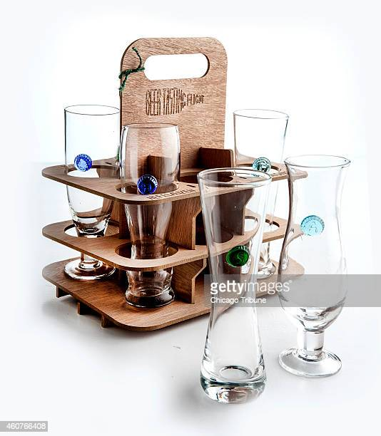 The Mini Beer Tasting Flight set from Anthropologie comes with a wooden carrier and six beer glasses that represent different styles of beer