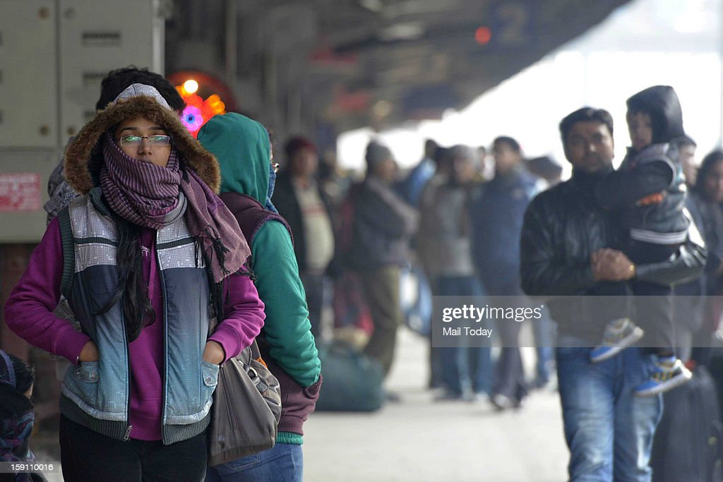 The minimum temperature in the Delhi dropped to 2.7 degrees Celsius on Monday. Passengers in railway station in chilly weather in New Delhi.