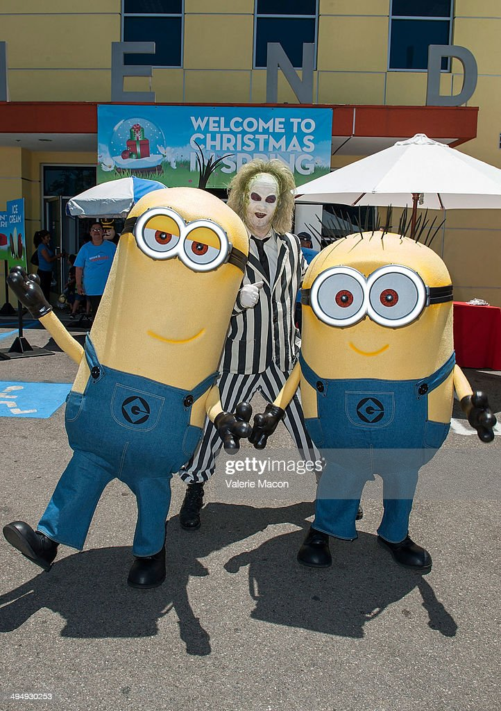 The Minions and Beetlejuice attend Universal Studios Hollywood 23rd Annual 'Christmas In Spring' Charity Event at M.E.N.D Transitional Living Center on May 31, 2014 in Pacoima, California.