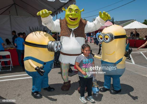 The Minions and Shrek attend Universal Studios Hollywood 23rd Annual 'Christmas In Spring' Charity Event at MEND Transitional Living Center on May 31...