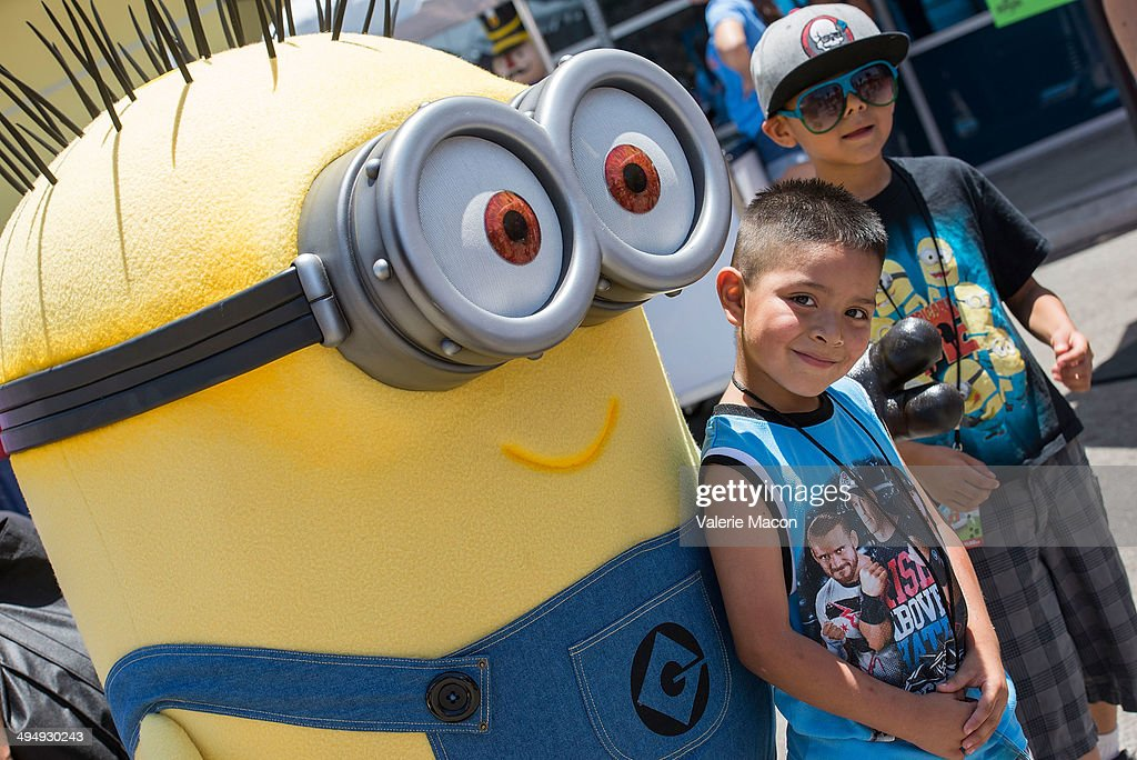 The Minions attend Universal Studios Hollywood 23rd Annual 'Christmas In Spring' Charity Event at M.E.N.D Transitional Living Center on May 31, 2014 in Pacoima, California.