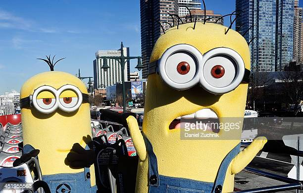 The Minions pose during the Gray Line New York Honors 'Despicable Me 2' With Ride Of Fame at Pier 78 on November 25 2013 in New York City