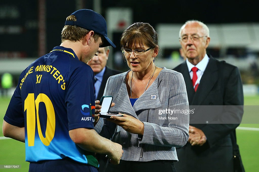 The Minister for Sport, Kate Lundy presents the man of the match trophy to James Faulkner of the PM's XI after the International Tour Match between the Prime Minister's XI and West Indies at Manuka Oval on January 29, 2013 in Canberra, Australia.