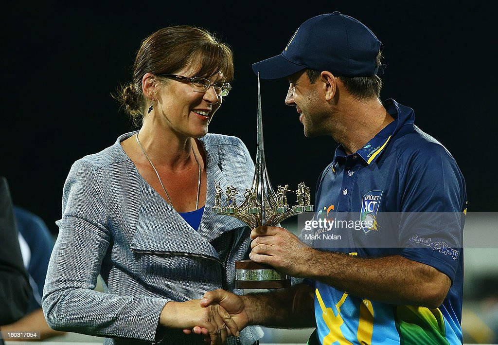 The Minister for Sport, Kate Lundy presents the trophy to <a gi-track='captionPersonalityLinkClicked' href=/galleries/search?phrase=Ricky+Ponting&family=editorial&specificpeople=176564 ng-click='$event.stopPropagation()'>Ricky Ponting</a> after the International Tour Match between the Prime Minister's XI and West Indies at Manuka Oval on January 29, 2013 in Canberra, Australia.