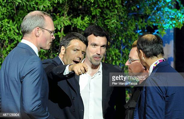 The Minister of Agriculture of Ireland Simon Coveney Italian Prime Minister Matteo Renzi Bono Vox and CEO of Expo Giuseppe Sala attend the event 'It...