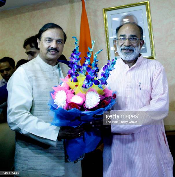 The Minister of State for Culture and Environment Dr Mahesh Sharma greets the new Minister of State for Tourism Shri Alphons Kannanthanam in New Delhi