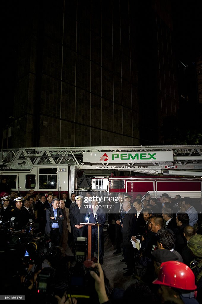 The Minister of the Interior, Miguel Angel Osorio Chong (C) addresses a press conference at the headquarters of state-owned Mexican oil giant Pemex in Mexico City on January 31, 2013, following a blast inside the building. An explosion rocked the skyscraper, leaving up to 25 dead and 101 injured, as a plume of black smoke billowed from the 54-floor tower, according to official sources. AFP PHOTO / YURI CORTEZ