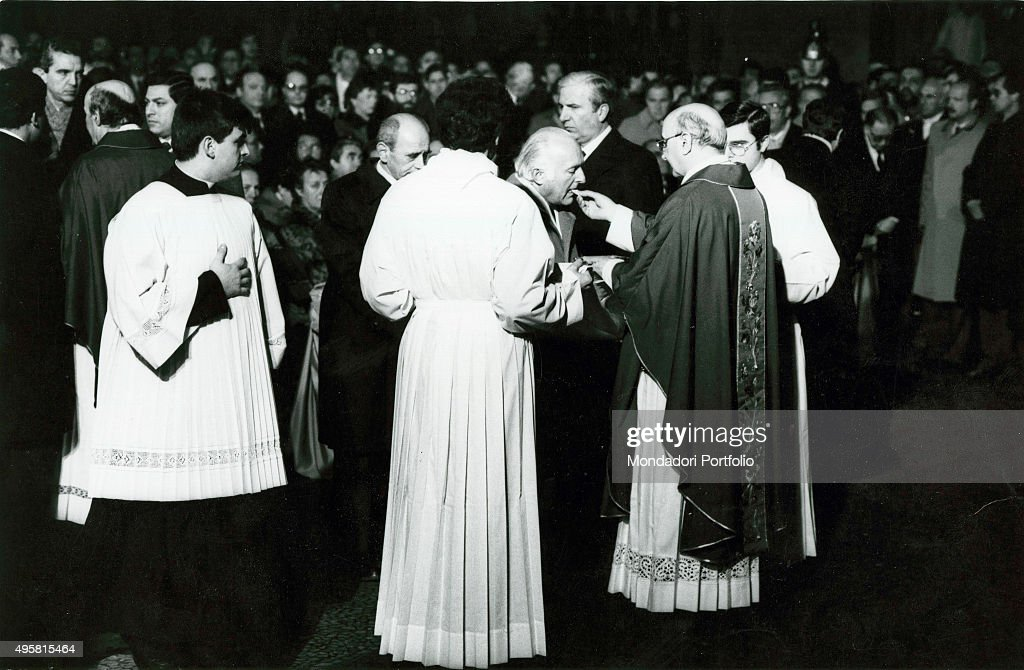 The Minister of the Interior of the Italian Republic Oscar Luigi Scalfaro receiving communion during the funeral of the victims of the Train 904...