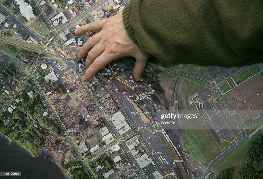 The ministry of Environment describes the most severely affected area of the train derailment in LacMegantic in an aerial photo of the site The path...