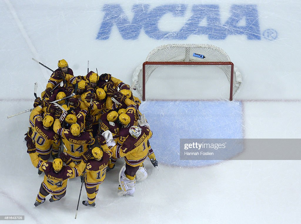 The Minnesota Golden Gophers celebrate a win in the final game against the St. Cloud State Huskies in the West Regional of the 2014 NCAA Division I Men's Ice Hockey Championship on March 30, 2014 at Xcel Energy Center in St Paul, Minnesota. The Minnesota Golden Gophers defeated the St. Cloud State Huskies 4-0.