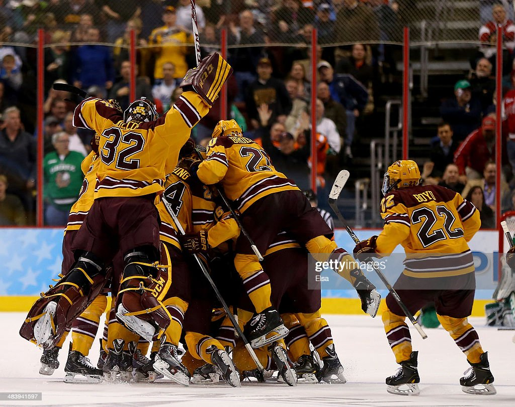 The Minnesota Golden Gophers celebrate after Justin Holl #12 scored the game winning goal with .6 of a second left in the third period against the North Dakota Fighting Sioux during the 2014 NCAA Division I Men's Hockey Championship Semifinal at Wells Fargo Center on April 10, 2014 in Philadelphia, Pennsylvania.The Gophers defeated the Fighting Sioux 2-1.