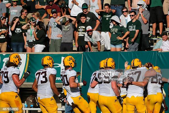 The Minnesota Golden Gophers celebrates touchdown by KJ Maye of the Minnesota Golden Gophers as the Colorado State Rams fans look on and the Golden...