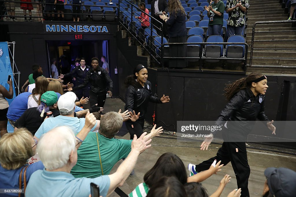 The Minnesota Lynx head out to the court high fiving fans before the game against the New York Liberty during the WNBA game on June 29, 2016 at Target Center in Minneapolis, Minnesota.