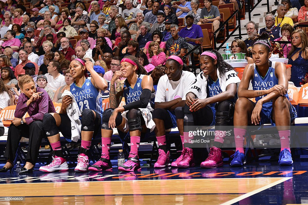The Minnesota Lynx look on from the bench during the game against the Connecticut Sun on July 27, 2014 at the Mohegan Sun Arena in Uncasville, Connecticut.