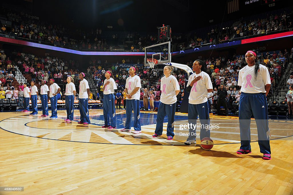 The Minnesota Lynx stand during the National Anthem before the game against the Connecticut Sun on July 27, 2014 at the Mohegan Sun Arena in Uncasville, Connecticut.