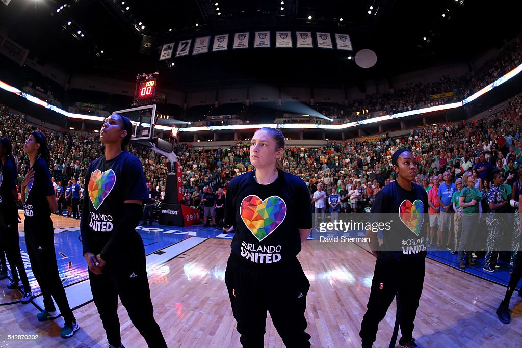 The Minnesota Lynx stand for a moment of silence for the National Anthem before the game against the Los Angeles Sparks during the WNBA game on June 24, 2016 at Target Center in Minneapolis, Minnesota.