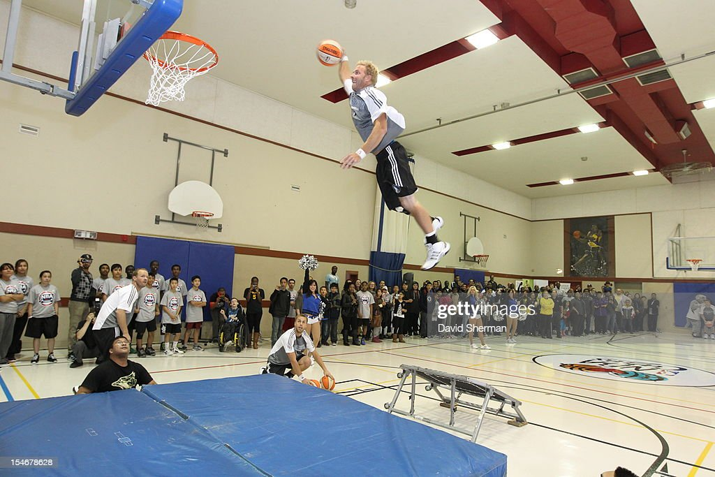 The Minnesota Timberwolves Dunk Team performs at the dedication of a refurbished basketball court during NBA Canada Series 2012 on October 23, 2012 at the Magnus Eliason Recreation Centre in Winnipeg, Manitoba, Canada.