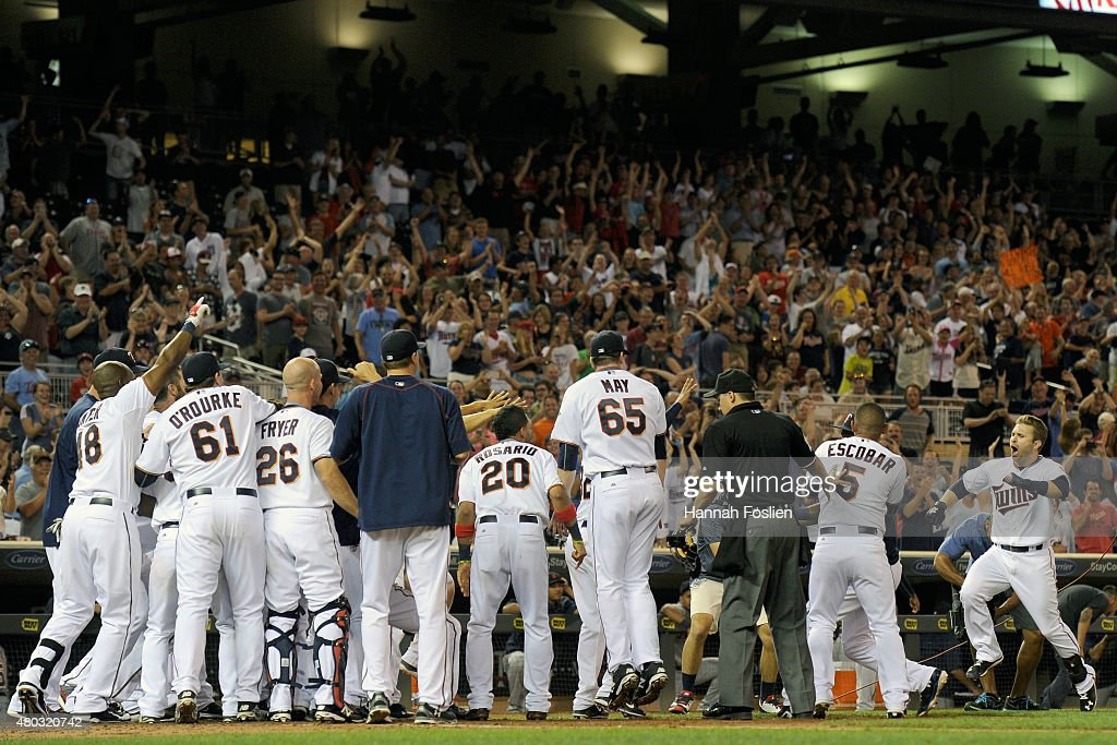 The Minnesota Twins celebrate a Brian Dozier heads into home plate after hitting a walkoff threerun home run against the Detroit Tigers during the...