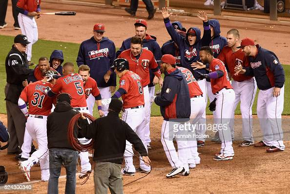 The Minnesota Twins celebrate a walkoff home run against the Cleveland Indians by Oswaldo Arcia during the ninth inning of the game on April 25 2016...