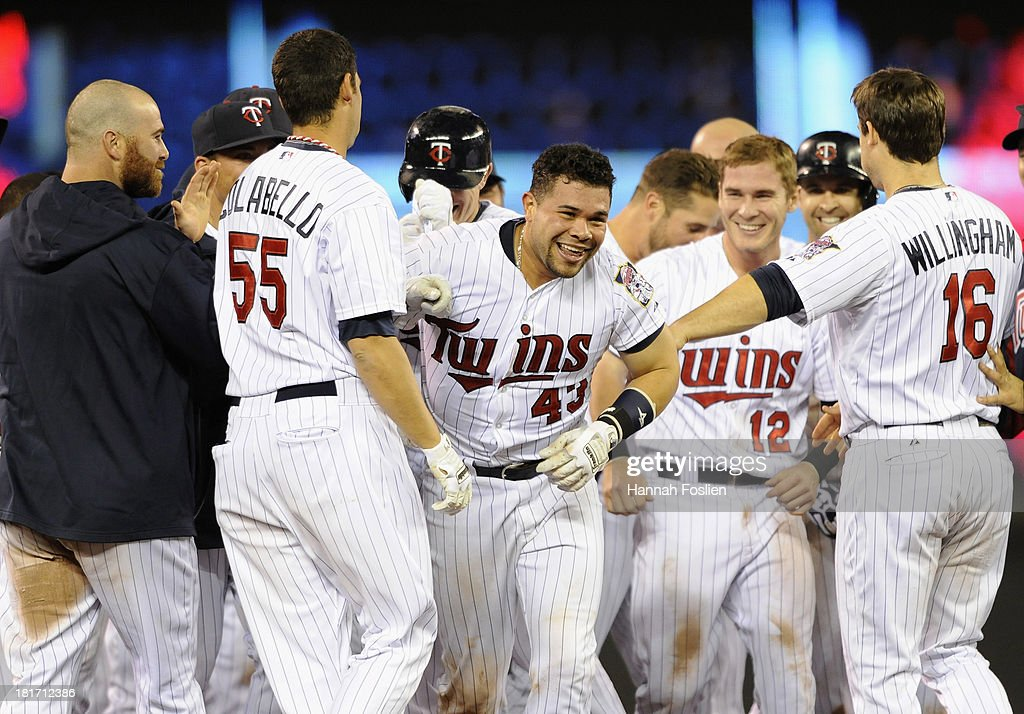 The Minnesota Twins celebrate a walk-off single by Josmil Pinto #43 after the game against the Detroit Tigers on September 23, 2013 at Target Field in Minneapolis, Minnesota. The Twins defeated the Tigers 4-3 in eleven innings.